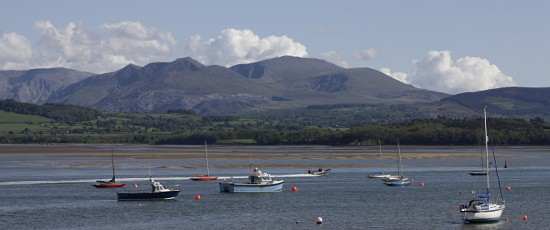 Image of boats on their moorings with Snowdonia in background