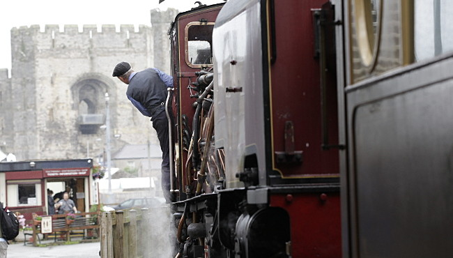 Welsh Highland Railway loco with Caernarfon Castle in background