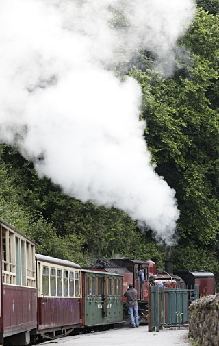 Welsh Highland railway loco moves to front of carriages ready for journey to Porthmadog