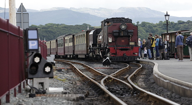 Welsh Highland Railway train prepares to leave Porthmadog for Caernarfon