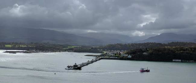 The pink mussel boat plying the Menai Strait below Coed y Berclas