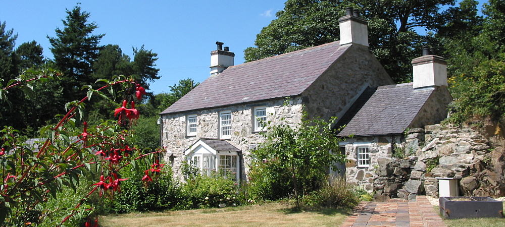 Coed y Berclas Holiday Cottage from the private orchard